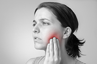 A woman suffering from jaw pain after a car accident!